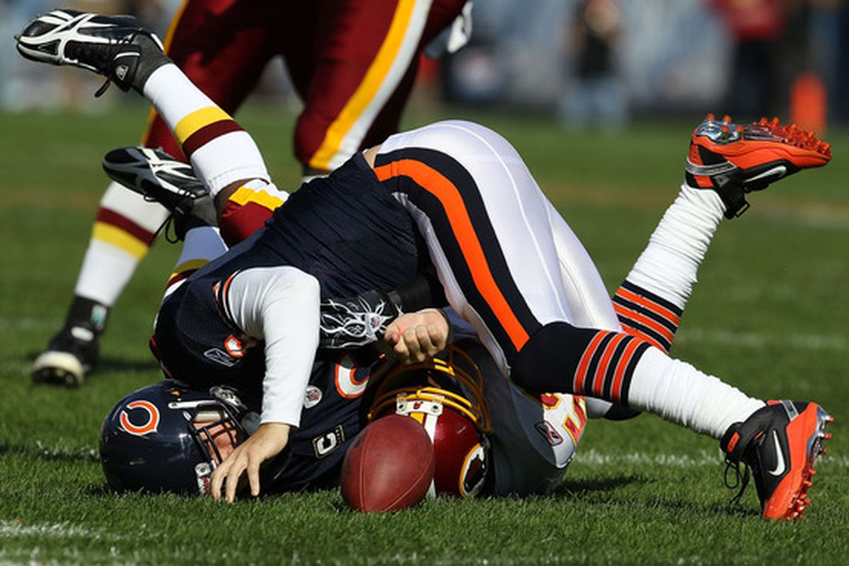 Jay Cutler of the Chicago Bears hits the ground after being sacked by Rocky McIntosh of the Washington Redskins at Soldier Field on October 24 2010 in Chicago Illinois.  (Photo by Jonathan Daniel/Getty Images)