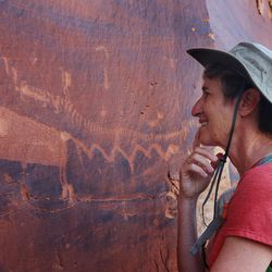 Interior Secretary Sally Jewell looks at rock art in Butler Wash near Bluff in southern Utah on Saturday, July 16, 2016.