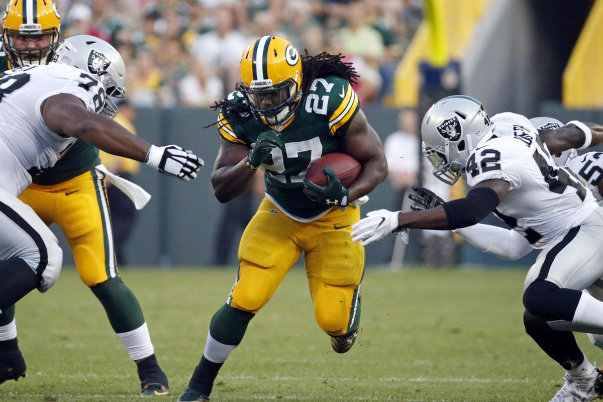 69814916331 Green Bay Packers running back Eddie Lacy (27) rushes against the Oakland  Raiders during the first half of an NFL preseason football game in Green  Bay