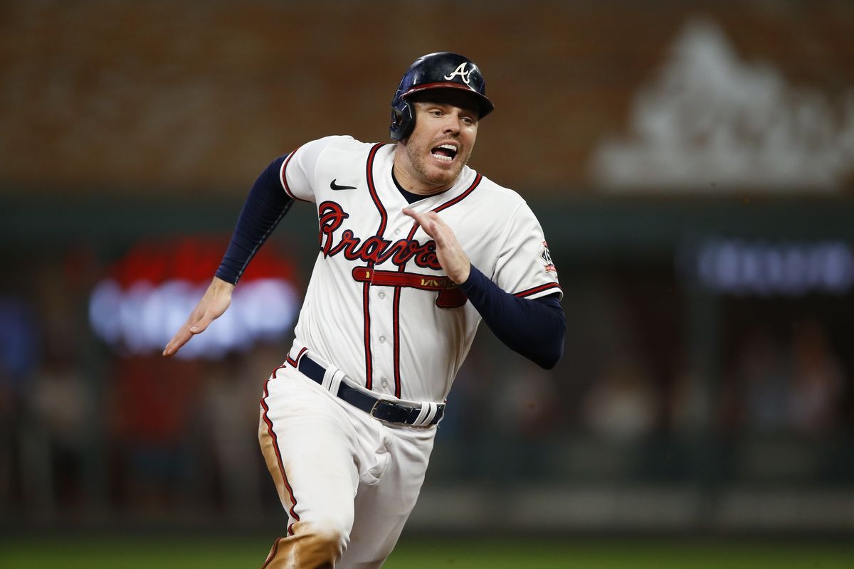 Freddie Freeman #5 of the Atlanta Braves runs to third during the sixth inning against the Milwaukee Brewers in game four of the National League Division Series at Truist Park on October 12, 2021 in Atlanta, Georgia.