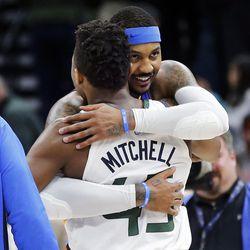 Utah Jazz guard Donovan Mitchell gets a hug from Oklahoma City Thunder forward Carmelo Anthony following NBA basketball in Salt Lake City on Saturday, Dec. 23, 2017.