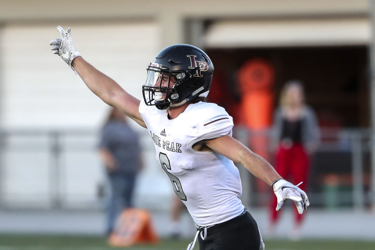 Lone Peak's Nate Ritchie celebrates after intercepting a Highland pass football game at Highland High School in Salt Lake City on Friday, Sept. 7, 2018.