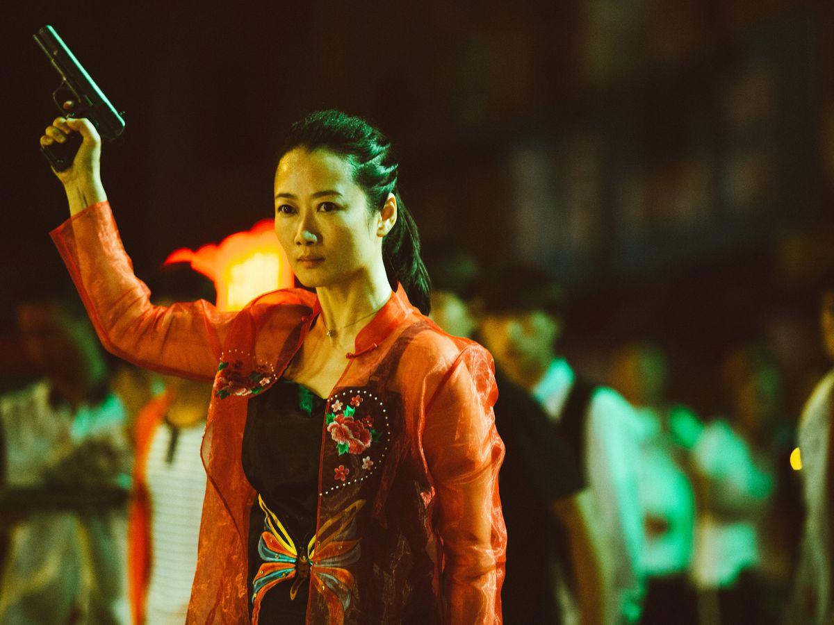 Zhao Tao wielding a gun in Ash is Purest White.