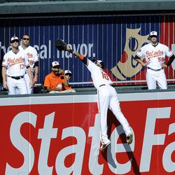 Baltimore Orioles center fielder Adam Jones (10) jumps in vain for a home run by New York Yankees' Curtis Granderson during the sixth inning of a baseball game on Sunday, Sept. 9, 2012, in Baltimore. The Yankees won 13-3.
