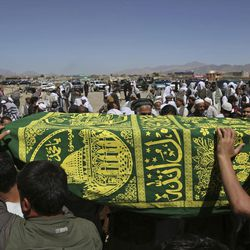 Men carry the coffin of a relative who died in Wednesday's massive bombing during his funeral, in the capital, Kabul, Afghanistan, Thursday, June 1, 2017. Afghans mourned the loss of family members, friends and colleagues on Thursday, a day after the truck bomb exploded in the capital leaving at least 90 people dead and more than 450 others wounded in one of the worst extremist attacks since the drawdown of foreign forces from Afghanistan in 2014.