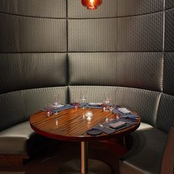 One of the booths upstairs at Gordon Ramsay Steak.