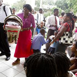 Members of the Torcelle Ward arrive for Sunday meetings at the Petionville LDS Meetinghouse in Petionville, Haiti.