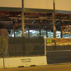 6:00 p.m. Another view, showing how deep the space is, that has been demolished over the front gate (Gate F) -