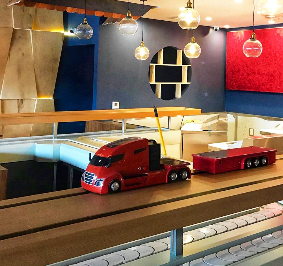 A semi truck toy at a restaurant