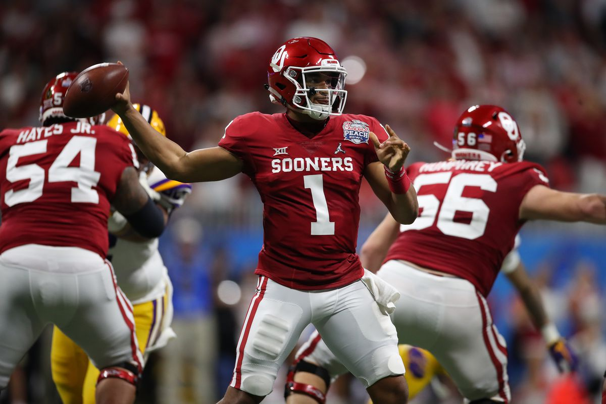 Jalen Hurts of the Oklahoma Sooners plays against the LSU Tigers during the College Football Playoff Semifinal in the Chick-fil-A Peach Bowl at Mercedes-Benz Stadium on December 28, 2019 in Atlanta, Georgia.