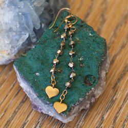 """Sheila B pyrite heart earrings, $70, available in-store at <a href=""""http://www.dandelionchocolate.com/store/"""">Mira Mira</a>"""