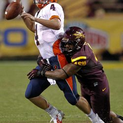 Illinois quarterback Reilly O'Toole (4) is sacked by Arizona State safety Chris Young during the second half of an NCAA college football game, Saturday, Sept. 8, 2012,in Tempe, Ariz.