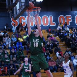 Lane's Vuk Djuric (33) tries a reverse lay-up against Proviso East, Wednesday 02-27-19. Worsom Robinson/For Sun-Times