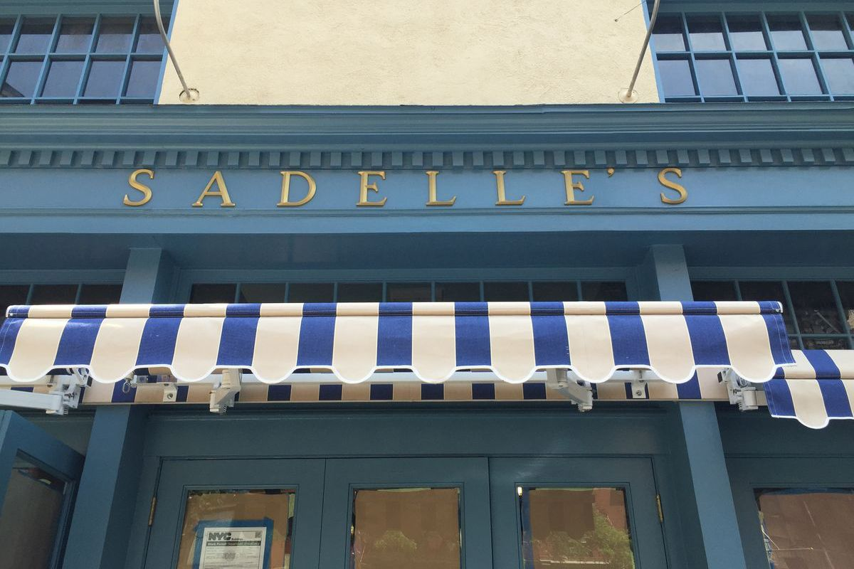 [The signage for the falls most anticipated opening, Sadelle's.]