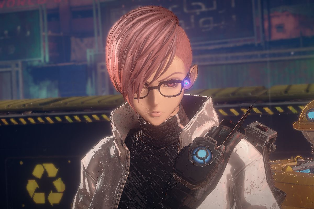 A woman with pink hair and stylish glasses stands on a helipad