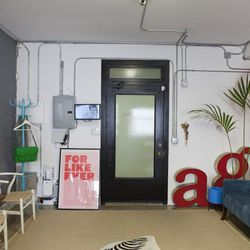 Lounge area at the studio entrance and very familiar initials in the corner.