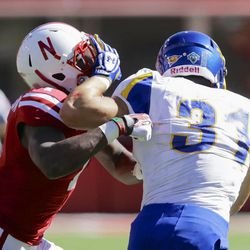 South Dakota State running back Zach Zenner (31) tries to get past Nebraska safety Harvey Jackson, left, in the first half of an NCAA college football game in Lincoln, Neb., Saturday, Sept. 21, 2013. (AP Photo/Nati Harnik)