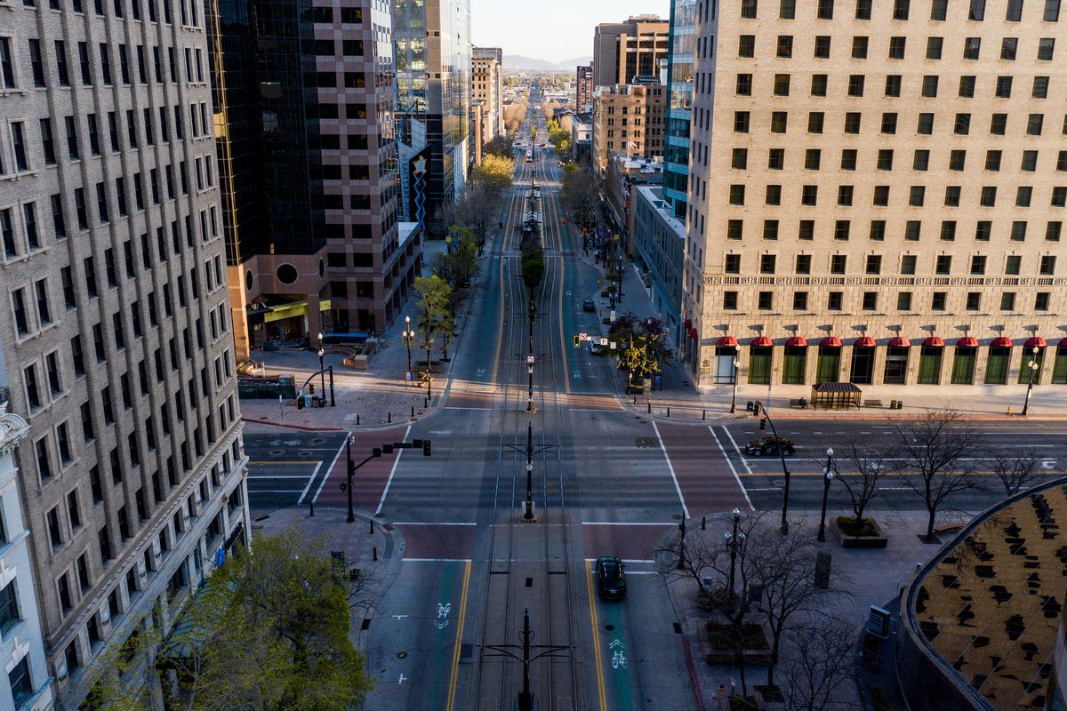 The streets of downtown Salt Lake City are unusually quiet on Tuesday, April 14, 2020.