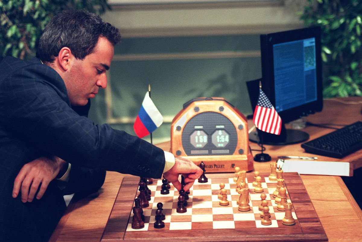 World Chess Champion Garry Kasparov (L) makes a move 07 May in New York during his fourth game against the IBM Deep Blue chess computer.