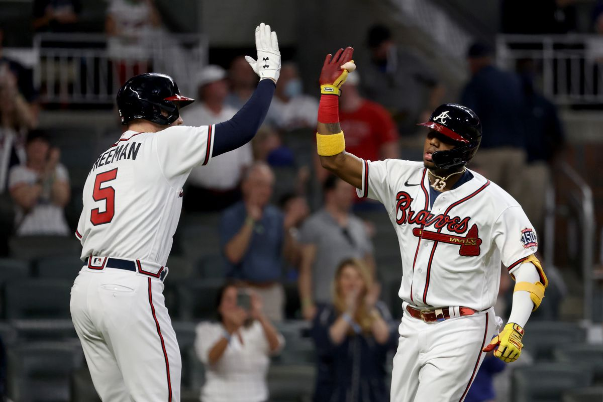 Atlanta Braves outfielder Ronald Acuna Jr. celebrates his solo home run with first baseman Freddie Freeman in the fifth inning against the Chicago Cubs at Truist Park.