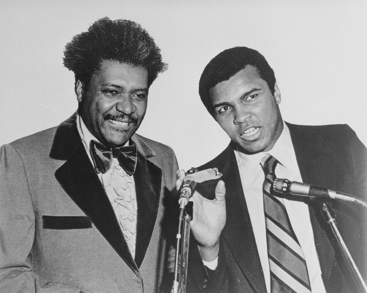 Muhammad Ali and Don King at Microphones