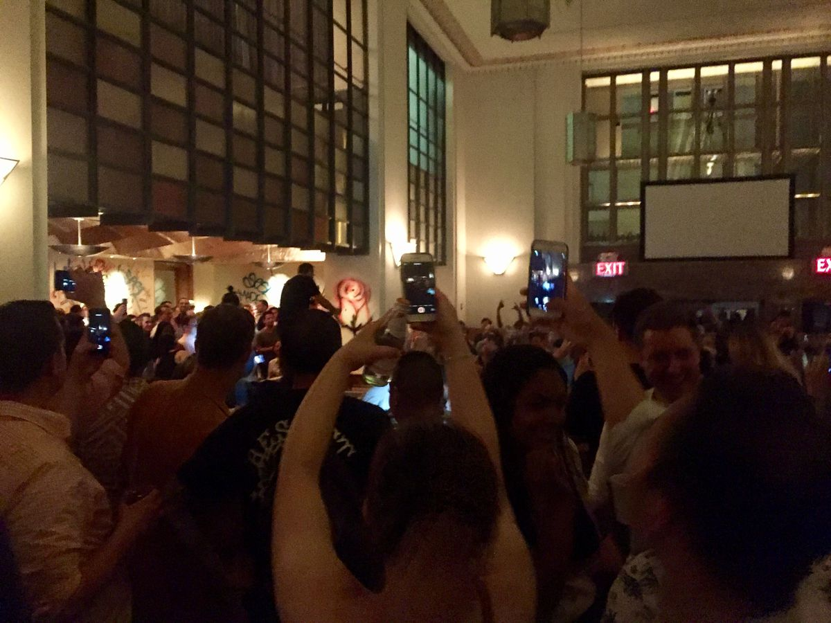 Daniel Humm spraying the crowd with champagne at Eleven Madison Park's closing party