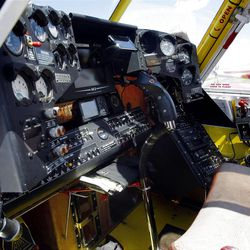 The cockpit of the 803 plane. The small, single-engine planes can get into tight places that tankers can't reach.