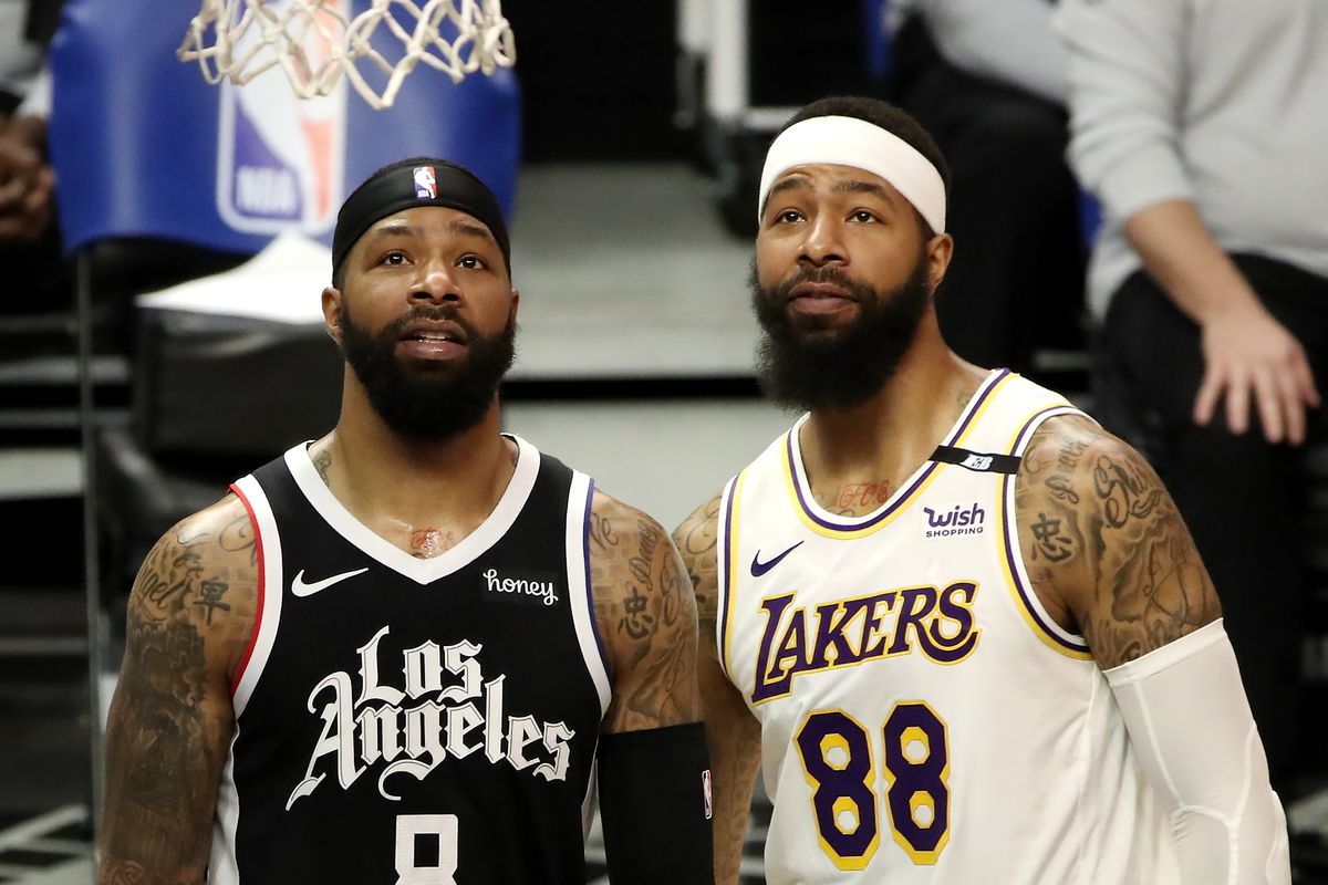 Markieff Morris of the Los Angeles Lakers and Marcus Morris Sr. of the Los Angeles Clippers look on during the game at Staples Center on April 04, 2021 in Los Angeles, California.