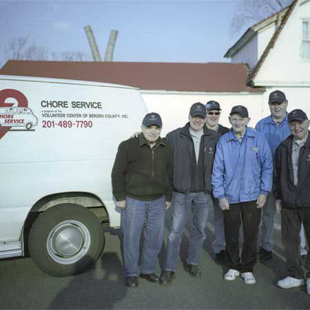 <p>From left to right, Chore Service volunteers Joe Madonna, Edward Morandi, Ralph Riese, Dick Boresen, Neil Lyman, and George Strauss meet before their Wednesday shift.</p>