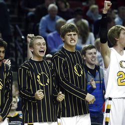 Orem players celebrate as time winds down and they advance as Bountiful and Orem play in the 4A semifinals Friday, March 2, 2012 at the Maverik Center in West Valley.