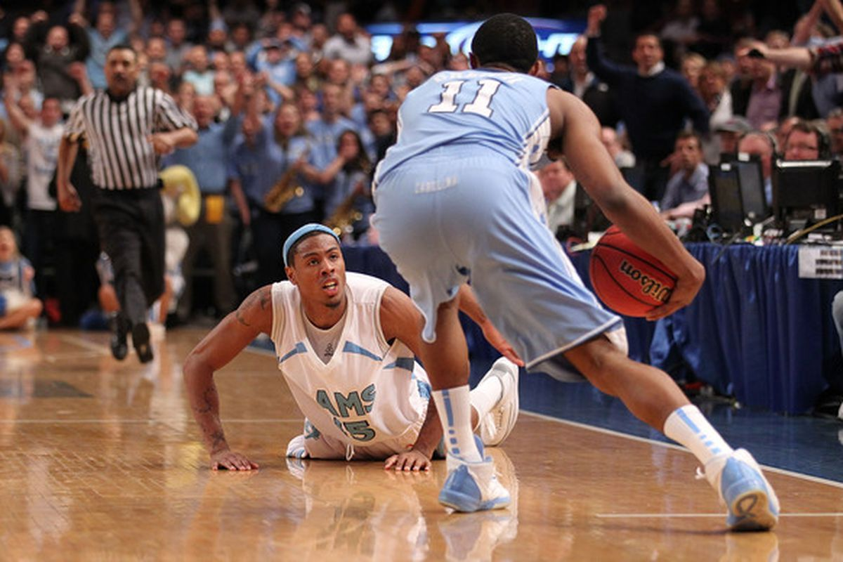 NEW YORK - MARCH 30:  Lamonte Ulmer #15 of the Rhode Island Rams reacts on the ground after losing control of the ball in the final seconds against the North Carolina Tar Heels at Madison Square Garden on March 30, 2010 in New York, New York.