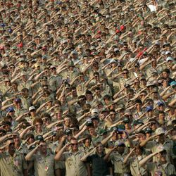 Boy Scouts and their leaders from across the country assume the Scout salute at the 2005 National Scout Jamboree at Ft. A.P. Hill, Virginia. Tens of thousands of Scouts will gather again soon for the 2010 National Scout Jamboree. AP file photo.