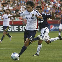 RSL's Fabian Espindola gets by Chivas USA's Mariano Trujillo Wednesday at Rio Tinto Stadium.