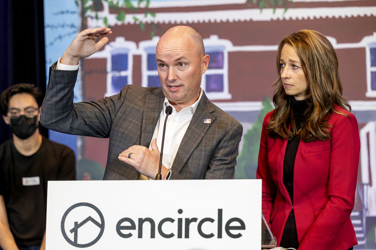 Gov. Spencer Cox, left, speaks at a press conference for Encircle at the Silicon Slopes Summit at the Salt Palace in Salt Lake City on Wednesday as his wife, Abby, looks on.