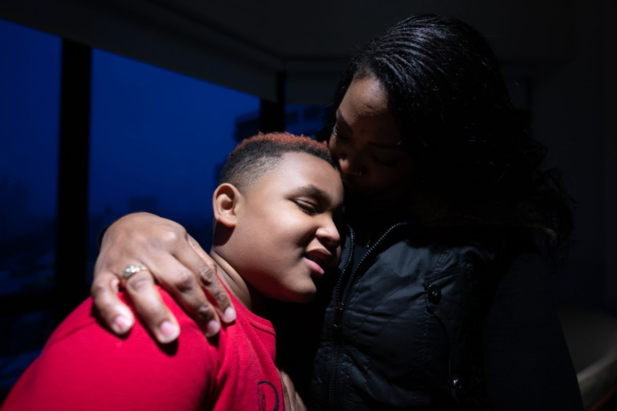 JaNay Dodson poses with her son, Braylin Harvey, in their Hyde Park building on Wednesday, March 17, 2021.