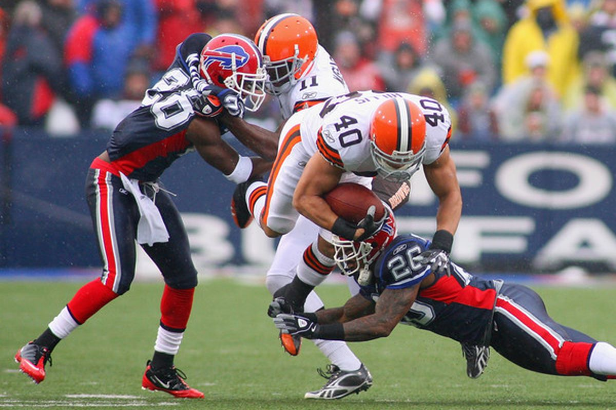 ORCHARD PARK NY - DECEMBER 12: Peyton Hillis #41 of the Cleveland Browns is tackled by Ashton Youboty #26 of the Buffalo Bills  at Ralph Wilson Stadium on December 12 2010 in Orchard Park New York.  (Photo by Rick Stewart/Getty Images)