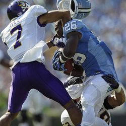 East Carolina's Lamar Ivey (7) and Jeremy Grove, bottom, hit North Carolina's Giovani Bernard (26) during the first half of an NCAA college football game in Chapel Hill, N.C., Saturday, Sept. 22, 2012.