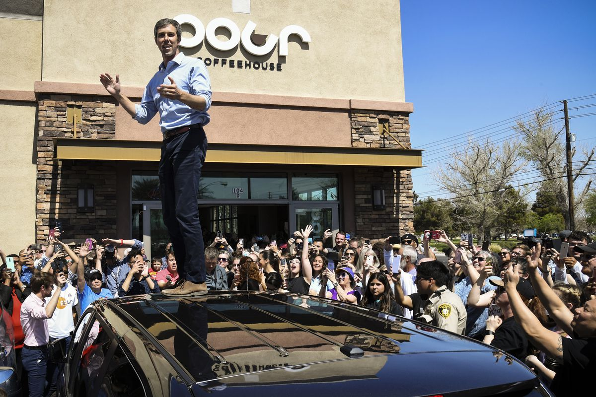 Beto O'Rourke (D-TX) stands on top of his vehicle to speak to an overflow of supporters at a meet-and-greet at Pour Coffeehouse on March 24, 2019 in Las Vegas, Nevada.
