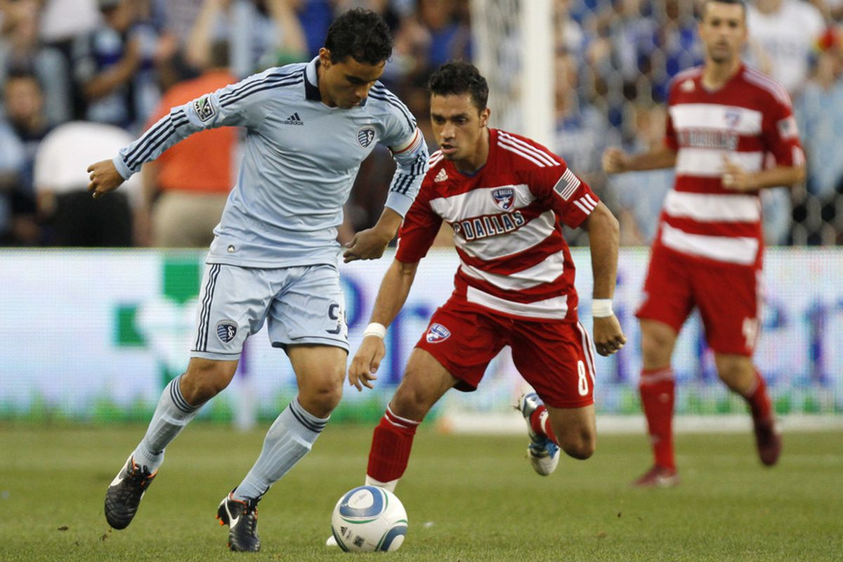 KANSAS CITY, KS - AUGUST 27:   Omar Bravo #99 of Sporting KC takes the ball past Bruno Guarda #8 of FC Dallas in the first half at Livestrong Sporting Park on August 27, 2011 in Kansas City, Kansas. (Photo by Ed Zurga/Getty Images)