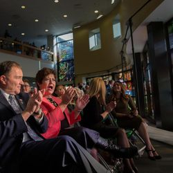 """Utah Gov. Gary Herbert and his wife, Jeanette Herbert, react to the unveiling of the """"Roots of Knowledge"""" stained glass window display at the Utah Valley University library on Friday, Nov. 18, 2016."""