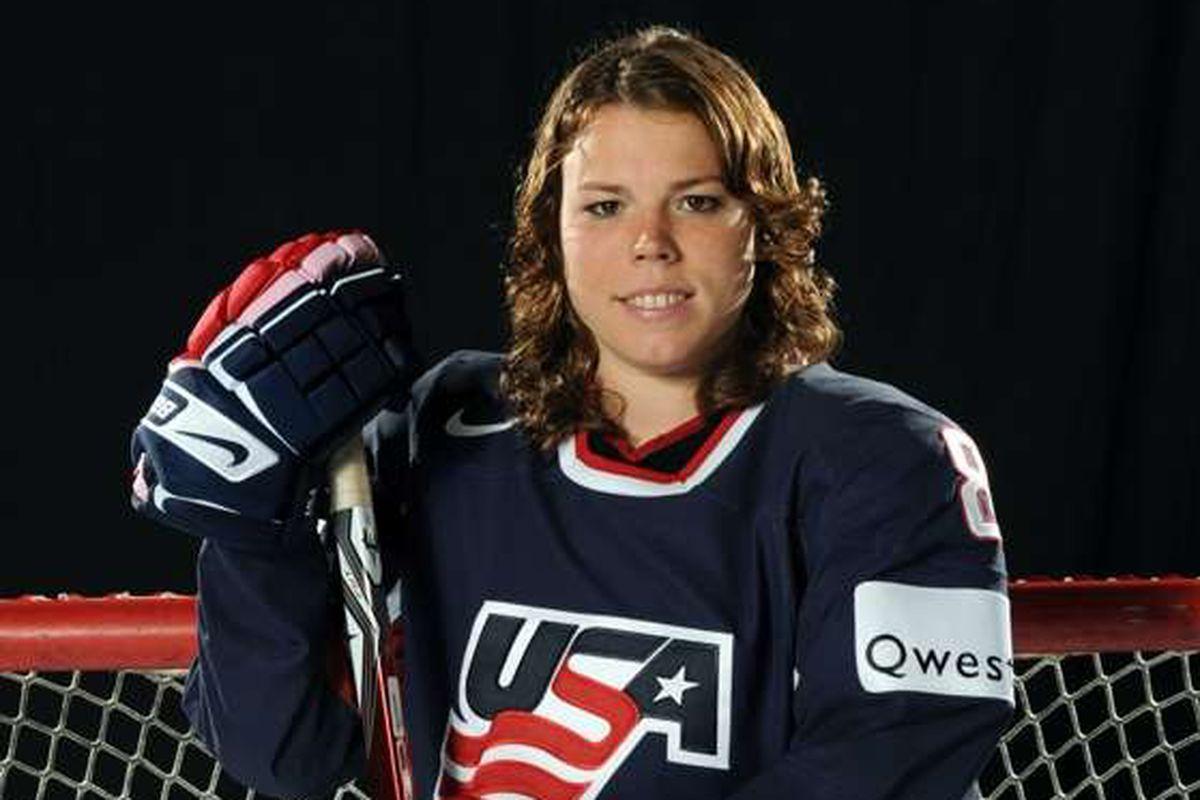 Caitlin Cahow tends goal for USA hockey