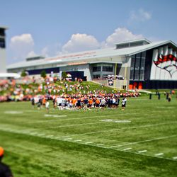 The team gathers around while the last words are said to close up day seven of Broncos Camp.