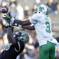Purdue cornerback Josh Johnson, left, breaks up a pass to Marshall wide receiver Aaron Dobson during the second half of an NCAA college football game in West Lafayette, Ind., Saturday, Sept. 29, 2012. Purdue defeated Marshall 51-41.