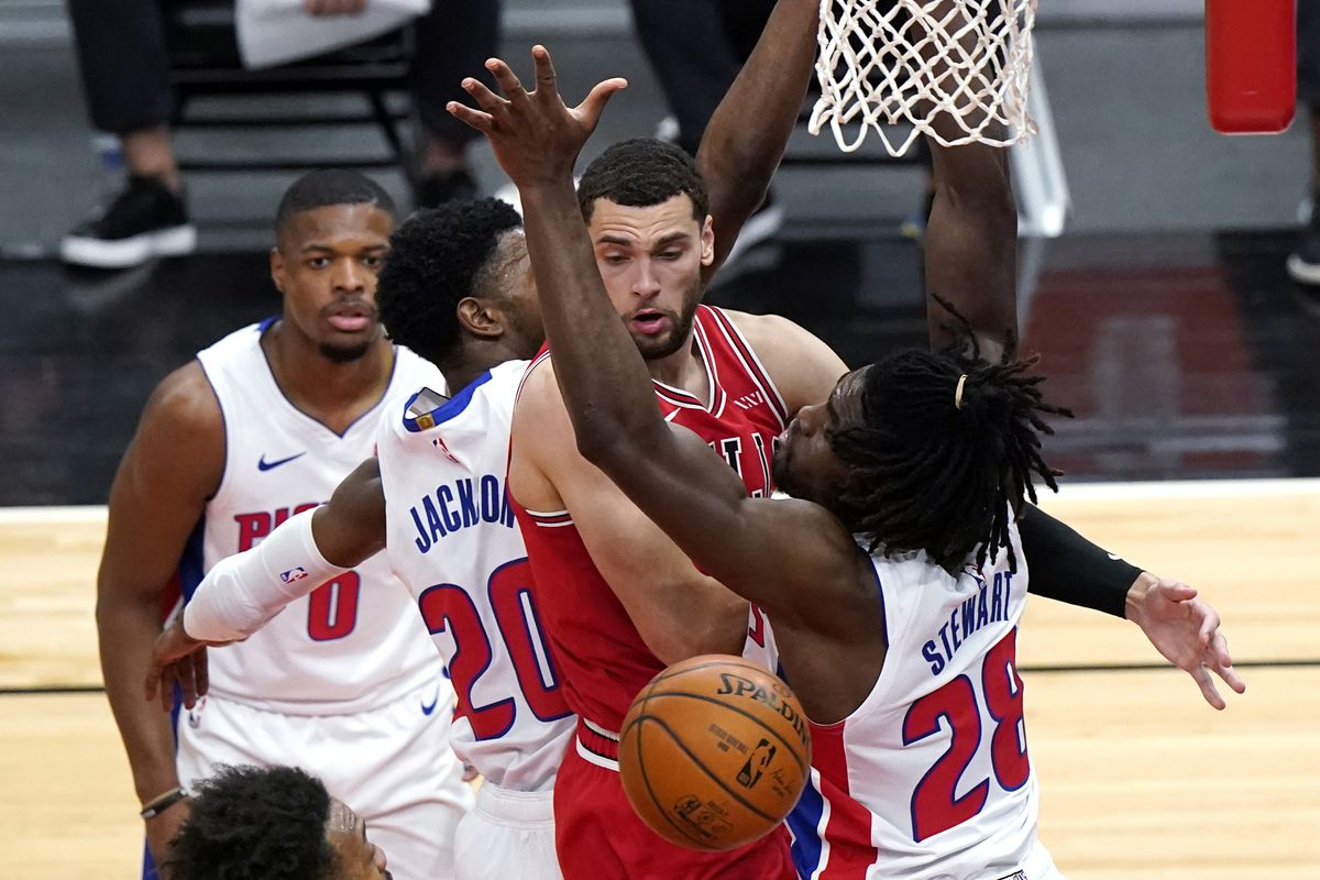 Bulls guard Zach LaVine passes the ball against the Pistons' Dennis Smith Jr., left, Josh Jackson and Isaiah Stewart during the first half Wednesday night.