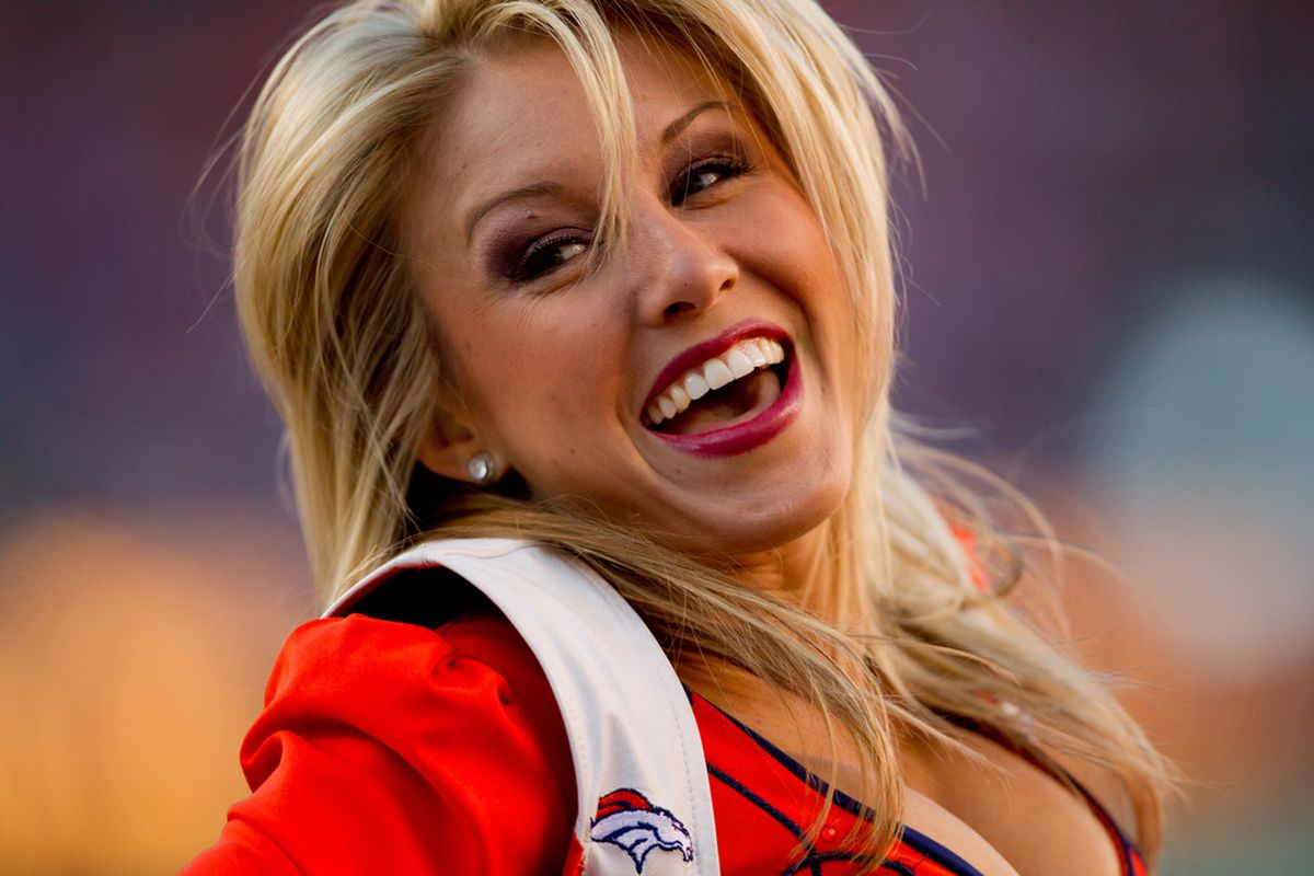 DENVER, CO - OCTOBER 30:  A Denver Broncos cheerleader performs during a break in the action at Sports Authority Field at Mile High in Denver, Colorado.(Photo by Justin Edmonds/Getty Images)