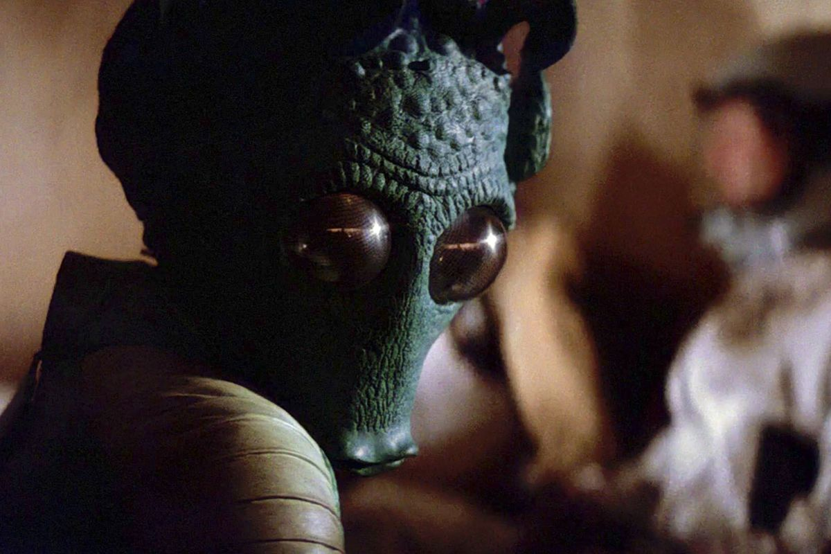 A still of Greedo, the green Rodian alien, from Star Wars: Episode IV — A New Hope
