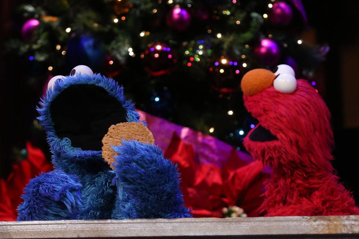 Cookie Monster and Elmo speak about the Christmas concert at the Conference Center in Salt Lake City on Friday, Dec. 12, 2014.