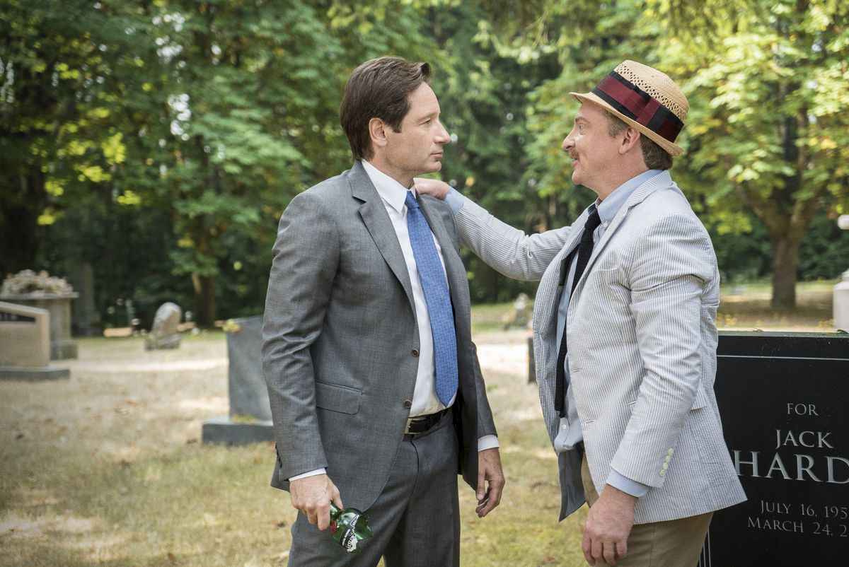 Mulder and Guy in the cemetery on The X-Files.