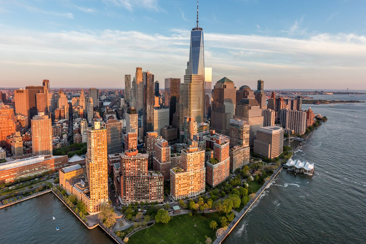 An aerial image of Battery Park City, looking towards the World Trade Center, during sunrise.