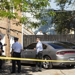 Chicago police personnel could be seen investigating on a back porch after an officer shot an alleged suspect inside an apartment in the 6200 block of West Grand Avenue, Monday morning, July 8, 2019.